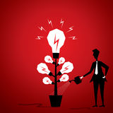 Idea plant. New idea bulb plant giving water by men stock Stock Images