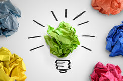 New idea concept. Colorful office paper balls and sketch of light bulb stock images