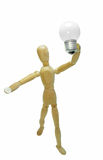 New idea concept. Man wood figure and light electrical bulb. New idea business concept. Man wood figure mannequins holding in arm a light bulb before itself royalty free stock photography
