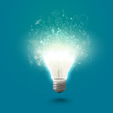 New idea. Conceptual image of electric bulb against blue background Stock Image