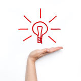 New idea with shining bulb on the palm Stock Image