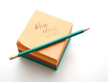 New ideas. Notes block and sharpened graphite pencil ready to use Stock Image