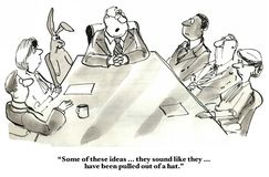 New Ideas. Business cartoon of people in a meeting, including a rabbit.  Boss says 'Some of these ideas... they sound like they... have been pulled out of a hat Royalty Free Stock Photo