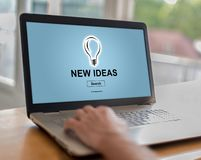 New ideas concept on a laptop. Man using a laptop with new ideas concept on the screen stock image