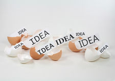 New Ideas Hatching. Birth of new ideas hatching out of eggshells royalty free stock photo