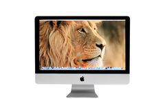 New iMac desktop computer. Mid 2011 model with Apple inc. launched a new operation system for desktop called Mac OS X Lion (version 10.7 royalty free stock photography