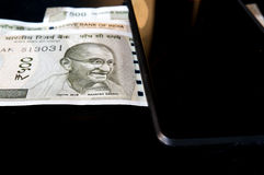New Indian currency with a mobile device Stock Images