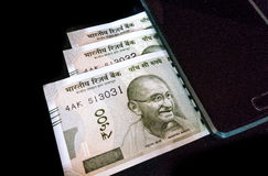 New Indian currency with a mobile device Stock Photography