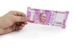 New Indian Currency Note in hands Stock Image