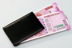 New Indian currency of 2000 rupee notes into the money purse. Stock Images