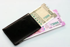 New Indian currency of 2000 and 500 rupee notes into the money purse. Royalty Free Stock Photography