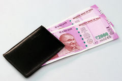 New Indian currency of 2000 rupee notes into the money purse. Royalty Free Stock Photos
