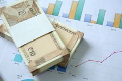 New Indian Currency Rupees from pack on the graph paper.  royalty free stock photo