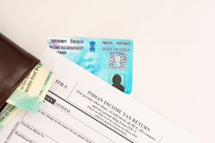 New Indian ITR-5 Income tax Form with indian currency and PAN or Permanent Account Number on isolated background stock photo