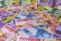 New Indonesia Rupiah Money. New Indonesia Bank Note look by a magnifer Stock Photo