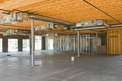 New Industrial Construction. A new building under construction and its architectural details Stock Photos