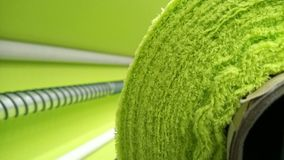 New industrial lime roll, green background. Concept: material, fabric, manufacture, garment factory, new samples of fabrics. Royalty Free Stock Photography