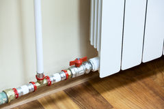 New installed domestic central heating register. With valve on pipe stock photo