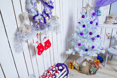 New interior corner. With white tree, purple baubles and gifts under the Christmas tree Stock Photography