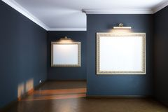 New interior gallery with wooden parquet and empty frames and lighters Stock Photos