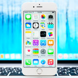 New iOS 8.1 homescreen on an white iPhone 6 display Royalty Free Stock Images