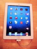 New ipad with a charging cable Royalty Free Stock Photos