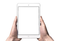 A new Ipad mini on hand. Man's hands holding an Apple new white ipad mini Royalty Free Stock Images