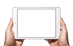 A new Ipad mini on hand. Man's hands holding an Apple new white ipad mini in horizontal mode Royalty Free Stock Image