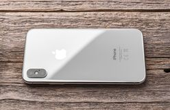 New iPhone X 10 on a wooden background, studio shot. royalty free stock images