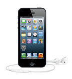 New IPhone 5 with headphones Royalty Free Stock Photo