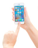 New Iphone 5 SE. WARSAW, POLAND - JULY 17: Someones hands holding and pointing at new Iphone 5 SE Royalty Free Stock Images