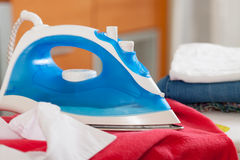 New iron on  ironing board Stock Photos