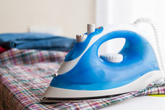 New iron on  ironing board Royalty Free Stock Photos