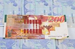 New Israeli Shekel. 200 hundred new Israeli shekel on top of other cash bills Royalty Free Stock Images