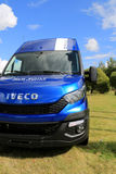 New Iveco Daily Van. RAISIO, FINLAND - AUGUST 24, 2014: New Iveco Daily Van parked on grass. 80% of components in Iveco daily have been redesigned royalty free stock photography