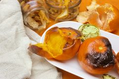 New Japanese superfood, grilled tangerines with the peel. A photo of the antioxidant grilled mandarine fruits, nuts and limes for Royalty Free Stock Image