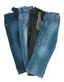 New jeans. New blue grey denim jeans isolated on white Stock Images