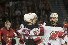 New Jersey Devils celebrate scoring a goal. Three New Jersey Devils celebrating scoring a goal  against the Ottawa Senators in National Hockey League action. The Royalty Free Stock Images