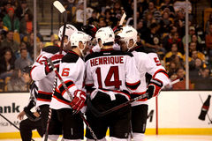New Jersey Devils score!. Members of the New Jersey Devils celebrate a goal from their November 15, 2011 game against the Boston Bruins.  Devils eventually lose Royalty Free Stock Photography