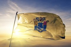 New Jersey state of the United States of America flag textile cloth fabric waving on the top. New Jersey flag textile cloth fabric waving on the top sunrise mist vector illustration