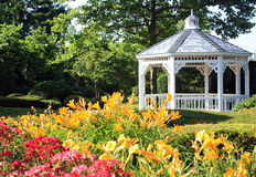 New Jersey Gazebo. Beautiful flower garden and Gazebo with yellow day lilies and roses in New Jersey royalty free stock photos