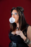 New Jersey housewife blowing a bubble. Sexy New Jersey housewife blowing a bubble Royalty Free Stock Photography