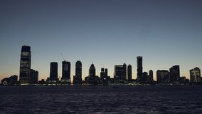 New Jersey panorama skyscrapers at evening, night, New York Skyline. Apartments and financial buildings. The skyline of. New Jersey at Sunset filmed from the stock video footage