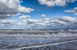 The New Jersey shore Atlantic Ocean at Manasquan NJ. With cumulous clouds in the sky Stock Photography