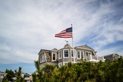 New Jersey shore. Beach house with american flag in New Jersey beach area stock photos
