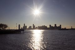 New Jersey skyline from New York city. During sunset stock photography
