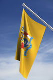 New Jersey state flag. Suspended from pole with sky in background; with clipping path royalty free illustration