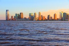 New Jersey. United States - NJ downtown skyline with Hudson river. Sunset light stock image