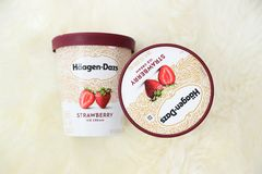 Container of Haagen-Dazs ice cream in strawberry flavor. New Jersey, USA - December 20, 2018:Container of Haagen-Dazs ice cream in strawberry flavor royalty free stock photos