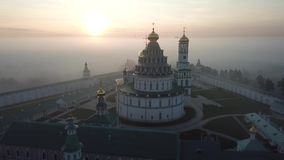 New Jerusalem monastery in Istra. New Jerusalem Orthodox monastery located in Istra. Morning mist landscape. Aerial view stock footage